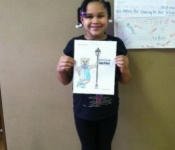 Student proudly showing off her work.